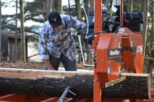 Facilities Director Chris Ripp uses Sac's new sawmill.